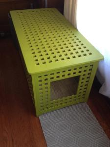 An IKEA hacked bench that works nicely as an open air litterbox cabinet.